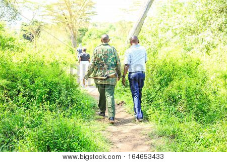 Ranger walking with tourists in Nairobi National Park Kenya
