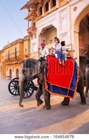 Amber, India - November 13: Unidentified People Ride Decorated Elephant In Jaleb Chowk In Amber Fort