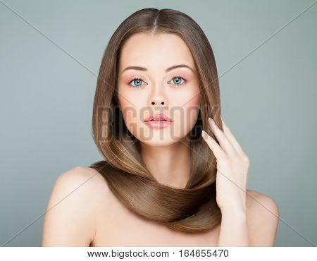 Beautiful Woman with Long Healthy Hair. Spa Model with Brown Shiny Hair