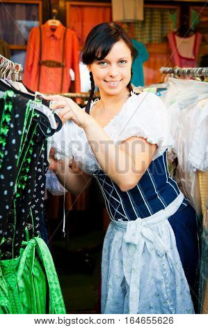 young woman shopping for a new dirndl