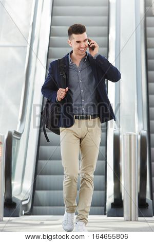 Happy Man On Telephone Call By Escalator