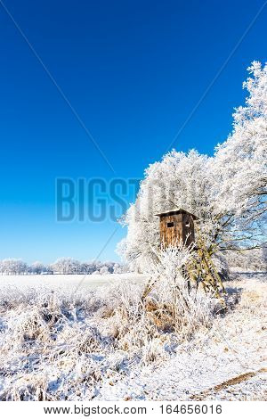 Wooden Brown Hunting Hideout Next To Frozen Trees