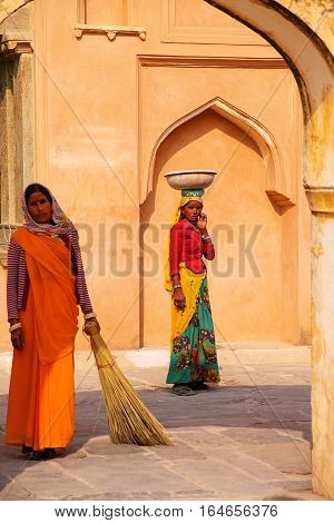 Amber, India - November 13: Unidentified Woman Walks With Pot On Her Head In Amber Fort On November