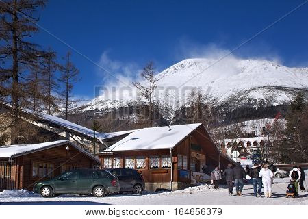 View of the High Tatras mountains with the peaks covered with snow from center of Stary Smokovec. Is a popular resort in Slovakia for skiing and hiking at an altitude of 990 m a.s.l.