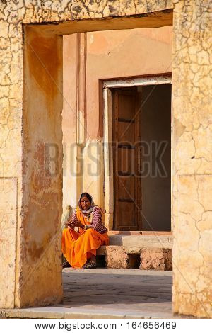 Amber, India - November 13: Unidentified Woman Sits In The Fourth Courtyard Of Amber Fort On Novembe