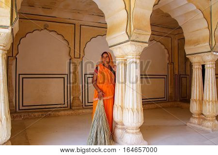 Amber, India - November 13: Unidentified Woman Stands In Sattais Katcheri Hall In Amber Fort On Nove