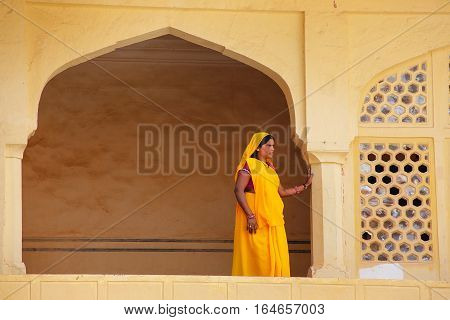 Amber, India - November 13: Unidentified Woman Stands On A Balcony In Amber Fort On November 13, 201