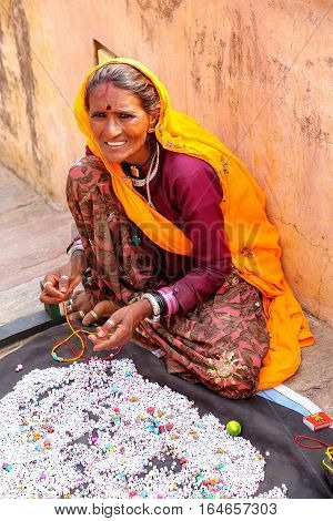 Amber, India - November 13: Unidentified Woman Makes Necklaces In Amber Fort On November 13, 2014 In