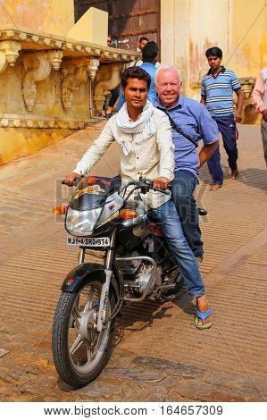 Amber, India - November 13: Unidentified People Ride Motorbike From Amber Fort On November 13, 2014