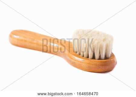 wooden brush with natural fibers isolated on white background