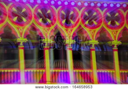 An abstract image of blurred lights being projected onto the side of a building for a holiday display on the island of macau lit up at night in Asia.