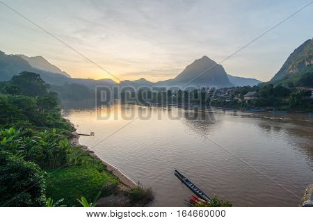 Sunset over the Ou River bisecting the town of Nong Khiaw in nothern Laos