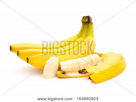 banana and banana slices and skin on white background