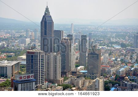 NANJING, CHINA - AUG. 6, 2012: Aerial view of Nanjing City center skyline (Northeast), viewed from Xinjiekou CBD, Nanjing, Jiangsu Province, China.