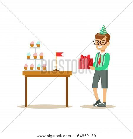 Boy Holding A Present Standing Next To Table With Cupcakes, Kids Birthday Party Scene With Cartoon Smiling Character. Part Of Children And Festive Celebration Attributes Series Of Vector Illustrations