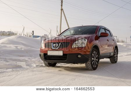 Nissan Qashqai in red color. This is crossover that combines modark design and compact hatchback refinement with functionality