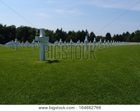 Rows of crosses in Hamm Cemetery in Luxembourg City on a sunny summer day mark the graves of fallen American Soldiers in World War II.