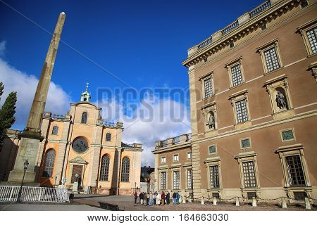 STOCKHOLM SWEDEN - AUGUST 19 2016: Church of St. Nicholas (Storkyrkan) and Obelisk located on the Slottsbacken street near the Royal Palace in Stockholm Sweden on August 19 2016.