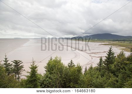 The view of St. Martins village Bay of Fundy beach famous for it's high sea tides (New Brunswick Canada).
