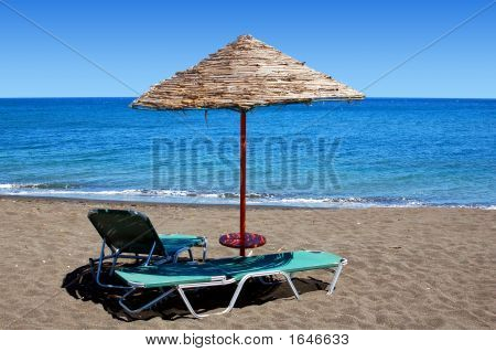 Black Beach Umbrella In Greece