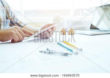 Architect Or Engineer Using Tablet For Working .