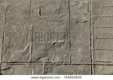 Stamped concrete slate end of the pattern, expansion joint on the right and down movement joint, pavement outdoor with decorative appearance colors and textures of paving slate stone tile top view