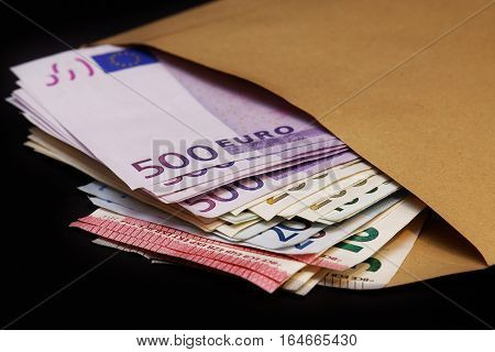 Several  euro banknotes in a large envelope