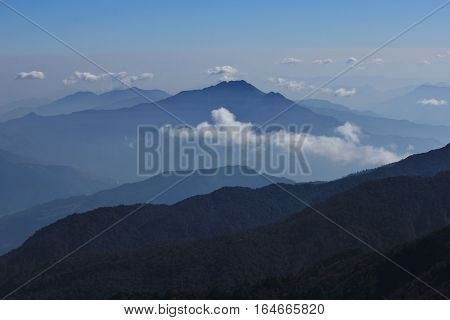 View from Mohare Danda Nepal. Hills near Pokhara on a fogy day. Blue light.