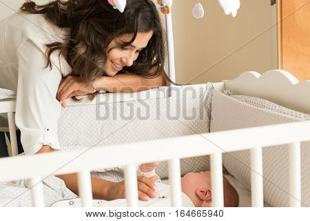 Mother Putting Baby To Sleep