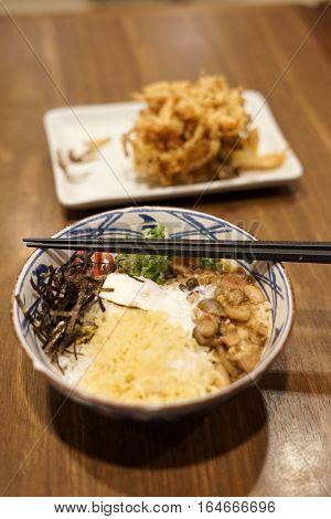 Japanese food Sukiyaki beef with rice on a bowl