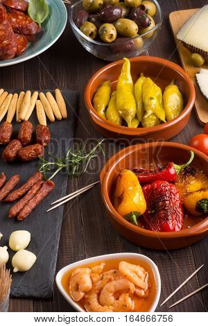 Top view of variety of mediterranean food starters - spanish tapas with chorizo and olives