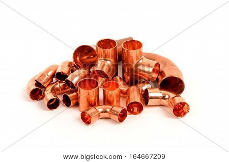 Copper elbowTee way copper pipes isolated on white background