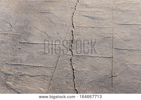 fractured surfaces of stamped concrete pavement outdoor, appearance colors and textures of paving slate stone tile on cement, flooring exterior decorative