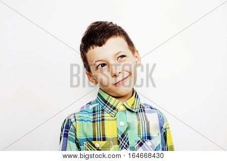 young pretty little cute boy kid wondering, posing emotional face isolated on white background, gesture happy smiling close up, lifestyle people concept