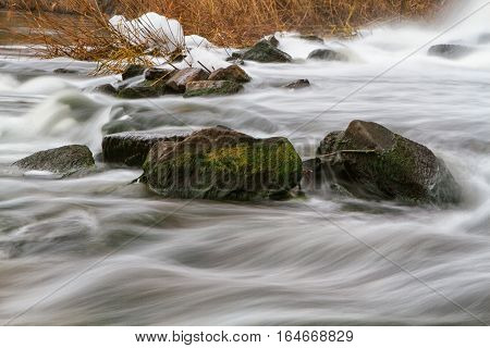 Autumn river view with waterfall on the river Kalmius located in Donetsk region