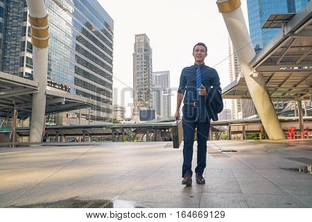 Young Handsome Businessman Walking Outdoors In Modern City