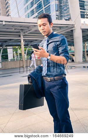 Handsome Man On Smart Phone - Young Business Man In Modern City.