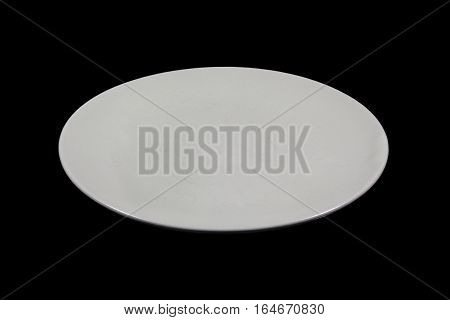 Flat off white shallow plate on black background directly from side