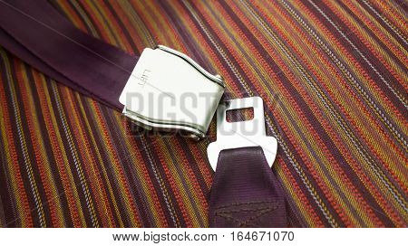 Purple seatbelt on plane for safety of passengers