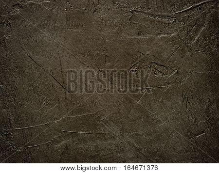 Dark grunge textured wall close up as background