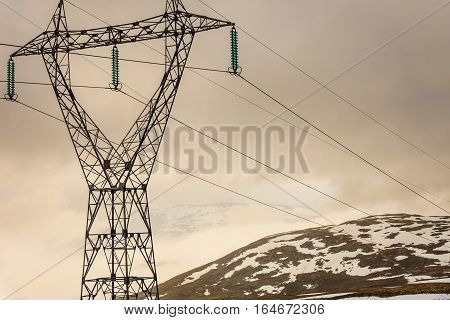Snowy Mountains With High Voltage Post