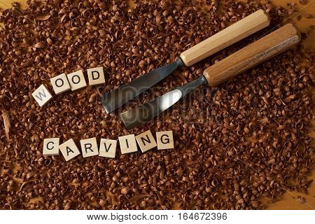 wood carving word writen with letters on wood chips with chisels
