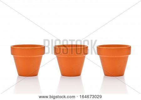 Three Terracotta Flower Pots Isolated On White