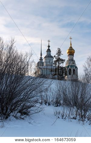 Vologda kremlin. Journey to the North of Russia. View from the frozen Vologda River. Church of Alexander Nevsky. Resurrection Cathedral St. Sophia Cathedral. Photo in frosty sunny winter day.
