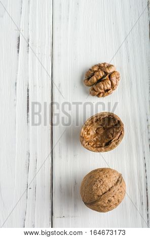 Whole And Shelled Walnuts On A White Wooden Background. The Core In Shell.
