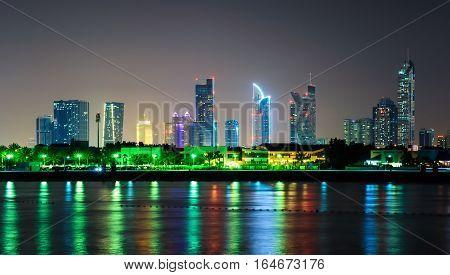 Amazing Night Dubai Downtown Skyline With Tallest Skyscrapers And Beautiful Jumeirah Beach Reflectio