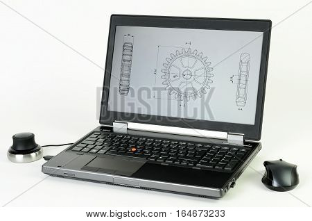 Laptop with CAD system and a gear wheel on the screen