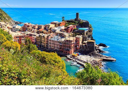 Vernazza famous fisherman village on steep Cinque Terre coast of Italy. Walking trail connects the villages.