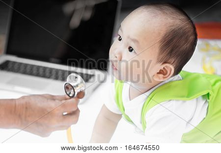 Baby Portrait With Stethoscope In His Grand Mother.