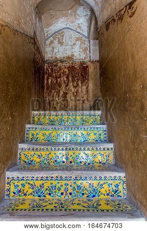 Isfahan Iran - October 20 2016: Tiled stairs in Ali Qapu palace in Isfahan city Iran
